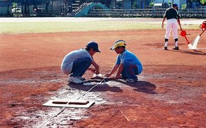 kids measuring to mound.jpg